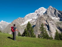 Hiker admiring mountain landscape around Mont Blan Royalty Free Stock Images