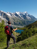 Hiker admiring mountain landscape in Val Veny, Mont Blanc Stock Photos