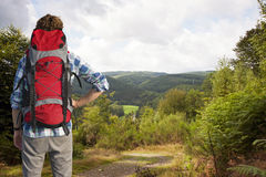 Hiker admiring a view Stock Images