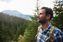 Hiker admiring the view high up in the hills Royalty Free Stock Photos