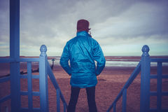 Hiker admiring view of sea from beach hut royalty free stock photo