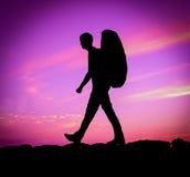 Hiker Against Purple Sunset Stock Photos