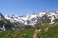 Hiker before the Alpine panorama Stock Images