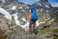 Hiker in Altai mountains Stock Photo