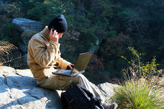 Hiker And Laptop Stock Images