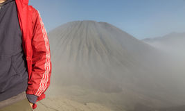 Hiker in anorak near Batok volcan Royalty Free Stock Photos