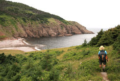 Hiker Approaching Fishing Cove Stock Images