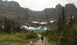 Hiker Approaching Iceberg Lake Stock Photos
