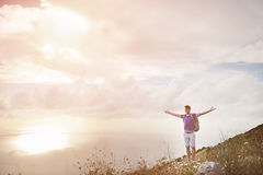 Hiker with arms wide open on top of a mountain - freedom conquest concept Royalty Free Stock Photo