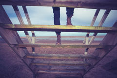 Hiker ascending steps to beach hut Royalty Free Stock Photos