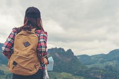 Hiker asia woman look binoculars and standing on mountain.  Female adventure backpack and camping on hike in outdoor nature. stock images