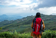 Hiker asian woman feeling victorious facing on the mountain, Thailand. Travel Concept Royalty Free Stock Image