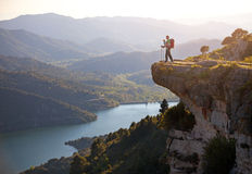 Hiker with baby relaxing on cliff Royalty Free Stock Photos
