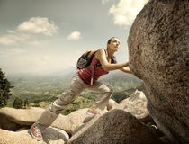 Hiker with backpack crossing rocky terrain. II Royalty Free Stock Photo