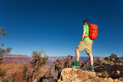 Hiker with backpack on the edge of Grand canyon Stock Photo