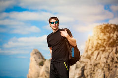 Hiker with backpack enjoying landscape Stock Photo