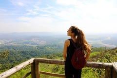 Hiker with backpack enjoying view from Jaragua Peak, Sao Paulo, Brazil.  stock photos