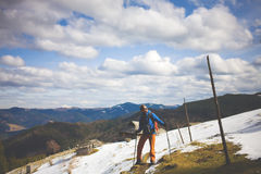 Hiker with backpack goes on the track. Royalty Free Stock Photos