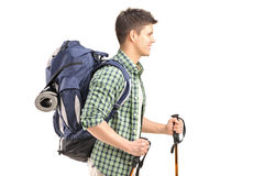 Hiker with backpack and hiking poles walking Stock Photography