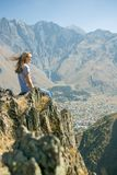 Hiker with backpack Hiking on the top of the mountain a Young Woman, a Girl. A Healthy Active Lifestyle. Adventure in Royalty Free Stock Image