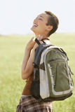 Hiker With Backpack Laughing In Field Stock Image
