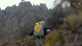 Hiker with backpack in the mountains stock video footage