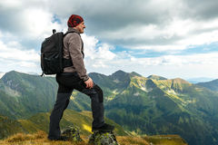 Hiker with backpack on mountains Stock Photos