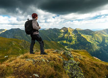 Hiker with backpack on mountains Royalty Free Stock Photos