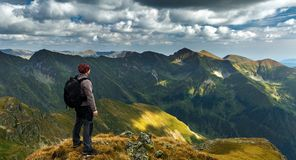 Hiker with backpack on mountains Stock Images