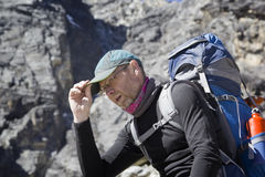 Hiker with backpack sitting and resting Stock Photo