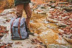 Hiker with backpack standing near a river Royalty Free Stock Images