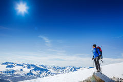 Hiker with backpack standing on top and enjoying tne view Stock Photo