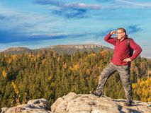 Happy hiker on the top of the mountain stock images