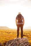 Hiker with backpack traveling in Norway mountains Dovre Stock Image
