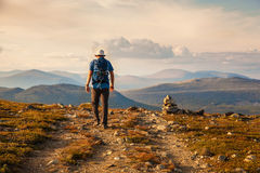 Hiker with backpack traveling in Norway mountains Dovre Royalty Free Stock Photo
