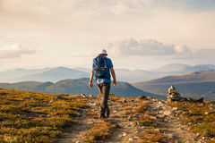 Hiker with backpack travelling in Norway mountains Dovre Stock Image