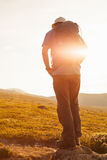 Hiker with backpack travelling in Norway mountains Dovre Stock Images