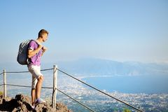 Hiker with backpack on Vesuvius looking panorama Royalty Free Stock Image