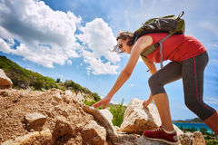 Hiker with backpack walking on seaside trail looking at beautifu Stock Photography