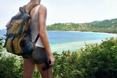 Hiker with backpacker and binoculars in hand enjoying view beati Stock Photo