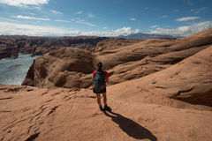 Hiker Backpacker looking at Lake Powell Royalty Free Stock Images
