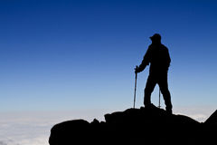 Hiker (backpacker) silhouette walking. Royalty Free Stock Photos