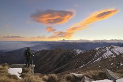 Hiker with backpacking observes the Alps Stock Photo