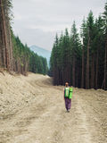 Hiker with backpacks walking on mountain road Stock Photo