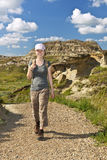 Hiker in badlands of Alberta, Canada Stock Photos
