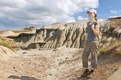 Hiker in badlands of Alberta, Canada Stock Photo