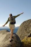 Hiker Balancing On Boulder At Coast Stock Images