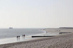 Hiker at the beach of Sylt in the morning light Stock Photos