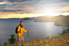 Hiker at beautiful sunrise above a big lake Royalty Free Stock Photography
