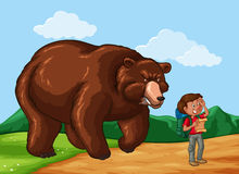 Hiker and big bear in the field Royalty Free Stock Image